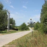 Поклонный крест на  въезде в с. Санино