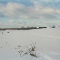 Деревня Митинская со стороны занесённого снегом родника