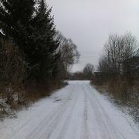 Въезд в деревню Попцово (справа видно угол старого магазина)