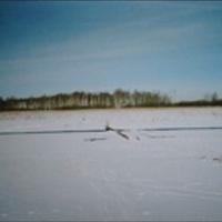 Озеро Свято. Вид на остров Березовый и незамерзшую протоку. Март 2003г.