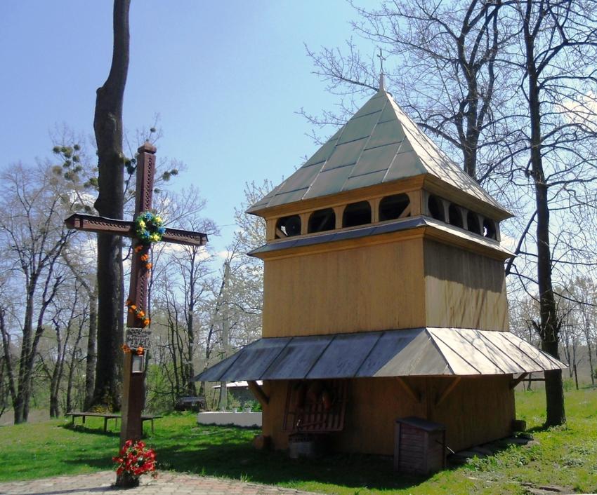 Wooden belfry of St. Basil's church in Bartativ